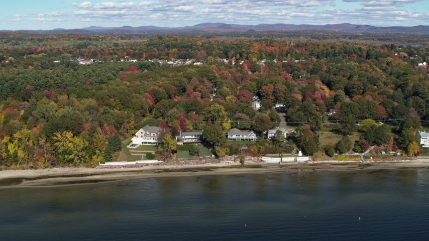 5.7K stock footage aerial video orbit four beachfront homes on the shore of Lake Champlain, Burlington, Vermont Aerial Stock Footage | DX0002_223_026