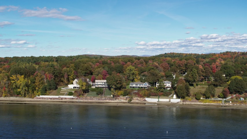 5.7K stock footage aerial video of reverse view of four beachfront homes on the shore of Lake Champlain, Burlington, Vermont Aerial Stock Footage | DX0002_223_028