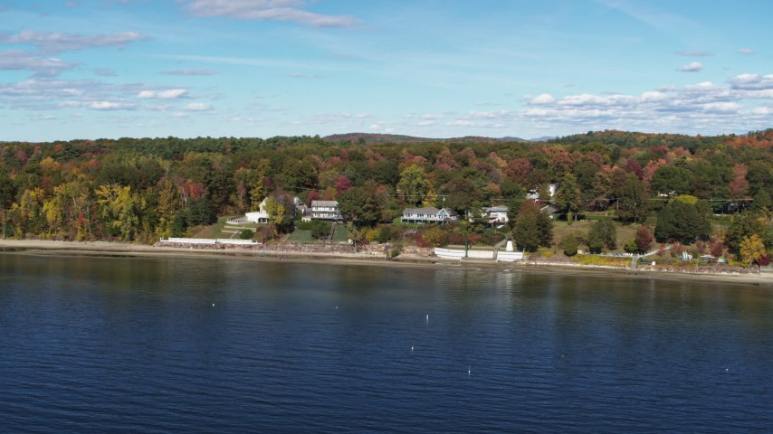 5.7K stock footage aerial video of circling four beachfront homes on the shore of Lake Champlain, Burlington, Vermont Aerial Stock Footage | DX0002_223_029