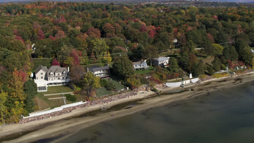 5.7K stock footage aerial video of orbiting four beachfront homes by the shore of Lake Champlain, Burlington, Vermont Aerial Stock Footage | DX0002_223_030