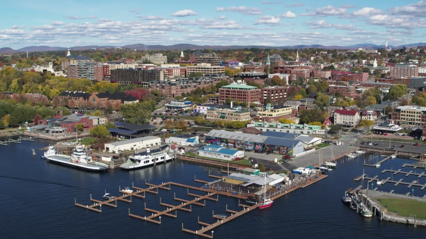5.7K stock footage aerial video of city buildings in downtown, seen from Ferry Dock Marina, Burlington, Vermont Aerial Stock Footage | DX0002_224_001