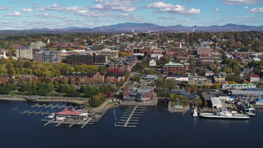 5.7K stock footage aerial video of orbiting city buildings and Burlington Community Boathouse Marina in downtown, Burlington, Vermont Aerial Stock Footage | DX0002_224_003