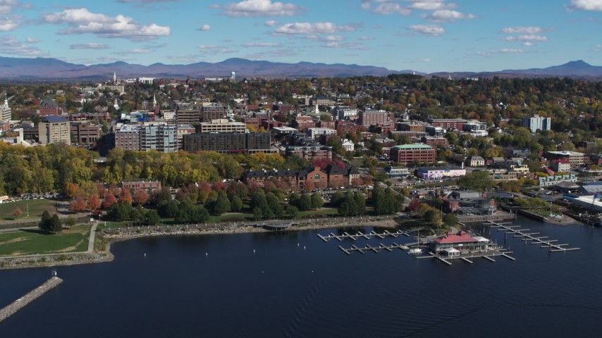 5.7K stock footage aerial video of orbiting city buildings, park and marina in downtown, Burlington, Vermont Aerial Stock Footage | DX0002_224_004