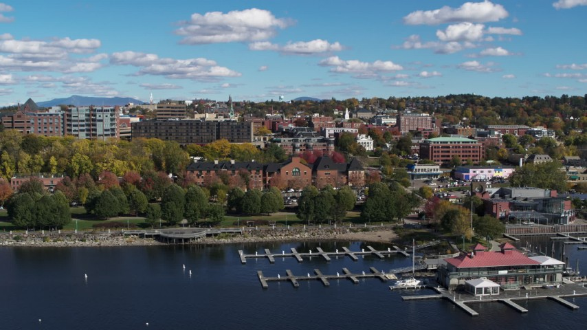 5.7K stock footage aerial video of downtown buildings behind Waterfront Park and a marina, Burlington, Vermont Aerial Stock Footage | DX0002_224_009
