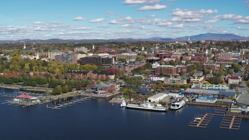 5.7K stock footage aerial video reverse view of downtown buildings and marinas, Burlington, Vermont Aerial Stock Footage | DX0002_224_011