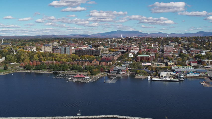 5.7K stock footage aerial video wide orbit of downtown buildings, seen from breakwaters, Burlington, Vermont Aerial Stock Footage | DX0002_224_012