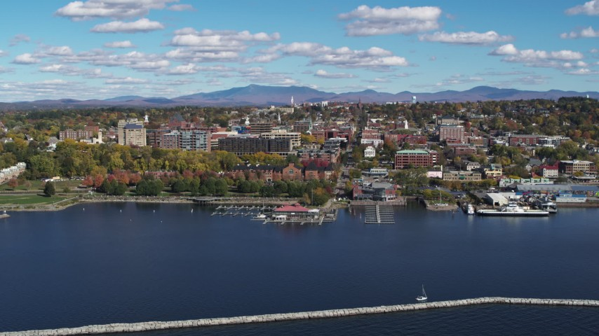 5.7K stock footage aerial video stationary view of downtown buildings from breakwaters, Burlington, Vermont Aerial Stock Footage | DX0002_224_013