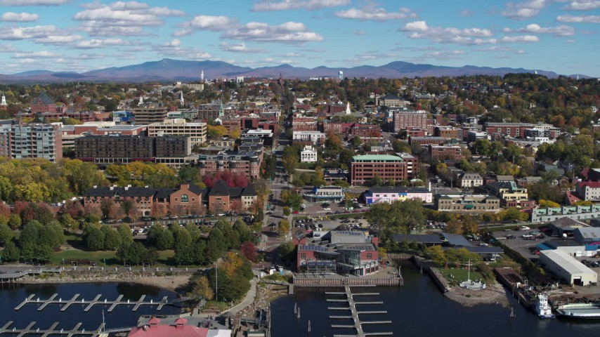 5.7K stock footage aerial video ascend from marina for view of city buildings and College Street, Burlington, Vermont Aerial Stock Footage | DX0002_224_018