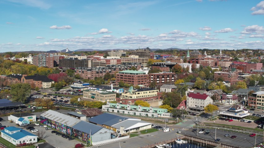 5.7K stock footage aerial video of circling buildings in downtown, reveal the marina, Burlington, Vermont Aerial Stock Footage | DX0002_224_022