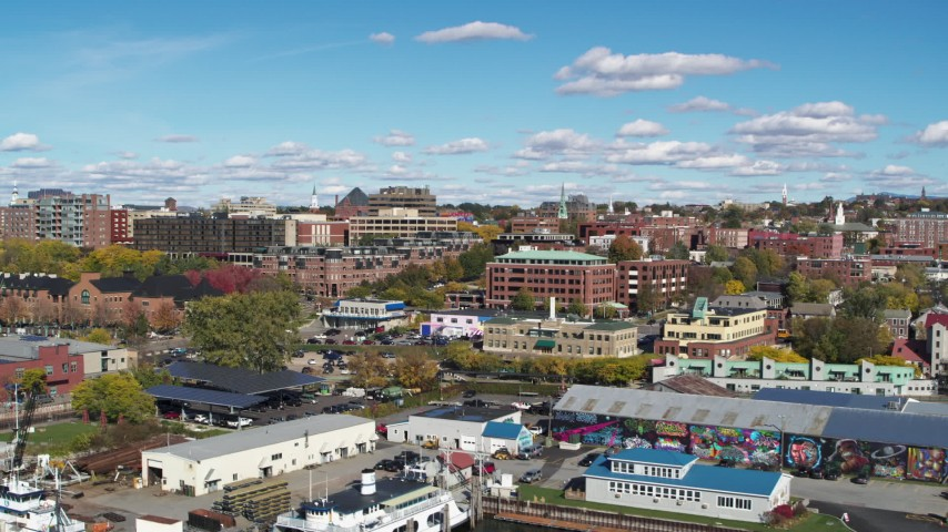 5.7K stock footage aerial video of buildings in downtown seen from marina, Burlington, Vermont Aerial Stock Footage | DX0002_224_023
