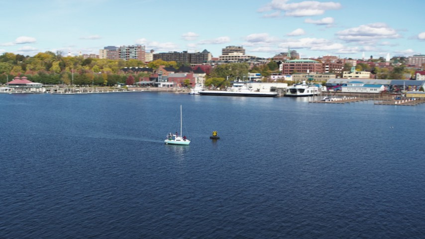 5.7K stock footage aerial video of orbiting a sailboat on Lake Champlain, reveal downtown, Burlington, Vermont Aerial Stock Footage | DX0002_224_024