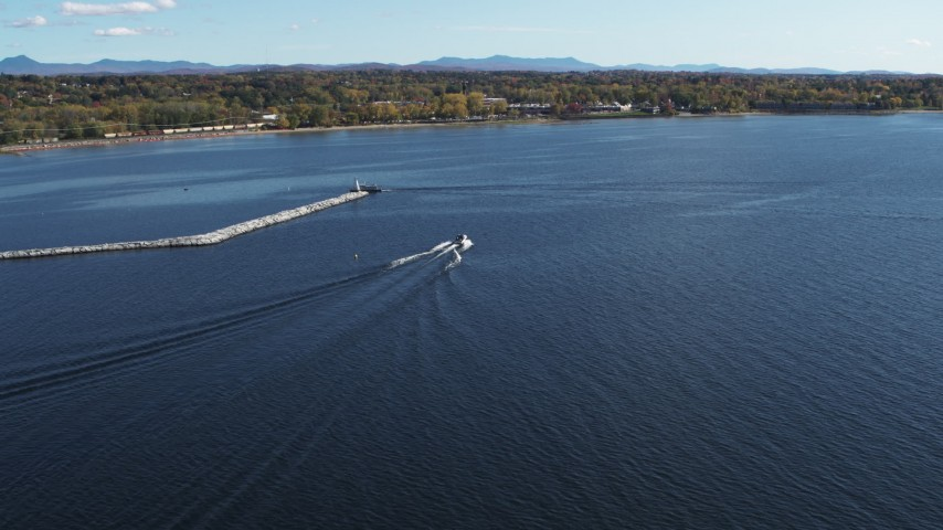 5.7K stock footage aerial video of tracking a speedboat racing past a breakwater on Lake Champlain near Burlington, Vermont Aerial Stock Footage | DX0002_224_026