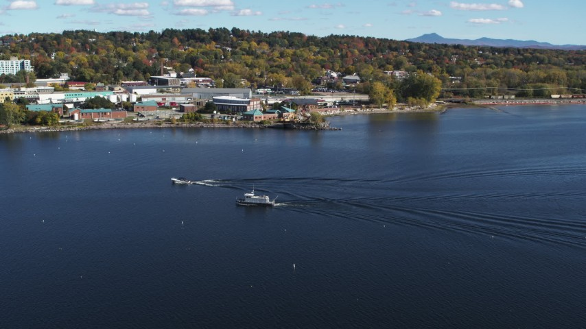 5.7K stock footage aerial video of a speedboat passing a boat on Lake Champlain near Burlington, Vermont Aerial Stock Footage | DX0002_224_029