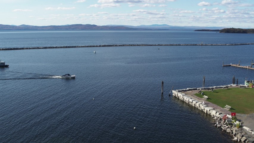 5.7K stock footage aerial video a speedboat approaching docks on Lake Champlain near Burlington, Vermont Aerial Stock Footage | DX0002_224_031