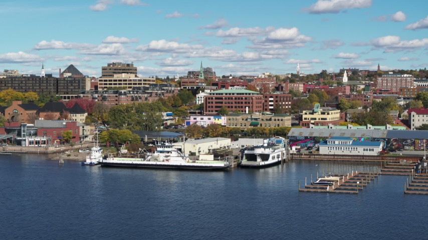5.7K stock footage aerial video orbit office building in downtown, seen from marina, Burlington, Vermont Aerial Stock Footage | DX0002_224_033