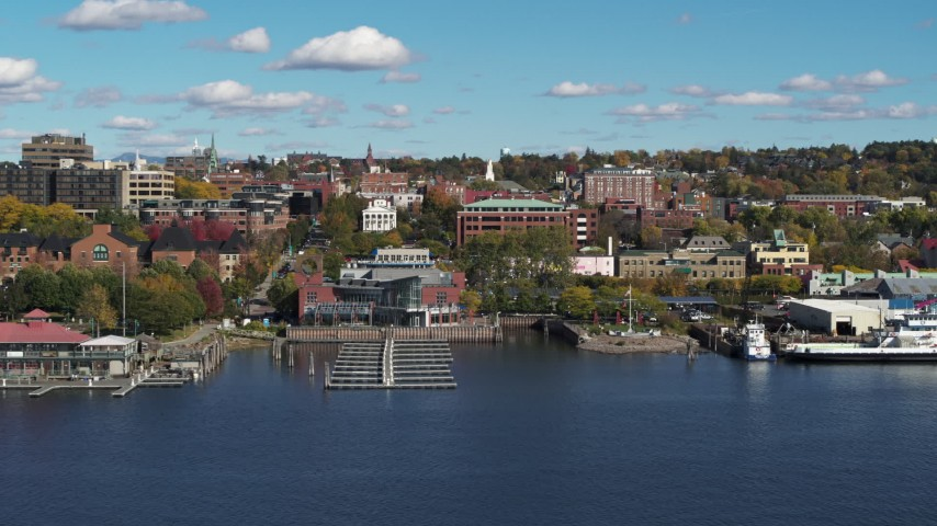 5.7K stock footage aerial video orbit office building in downtown, seen from a marina, Burlington, Vermont Aerial Stock Footage | DX0002_224_034