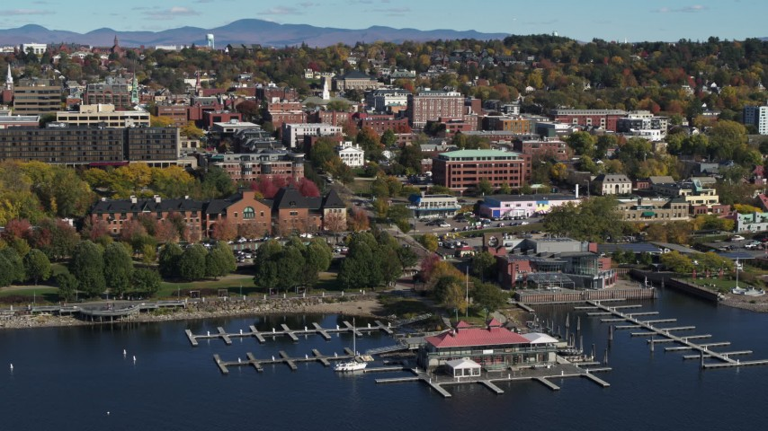 5.7K stock footage aerial video wide orbit office building in downtown, seen from a marina, Burlington, Vermont Aerial Stock Footage | DX0002_224_035