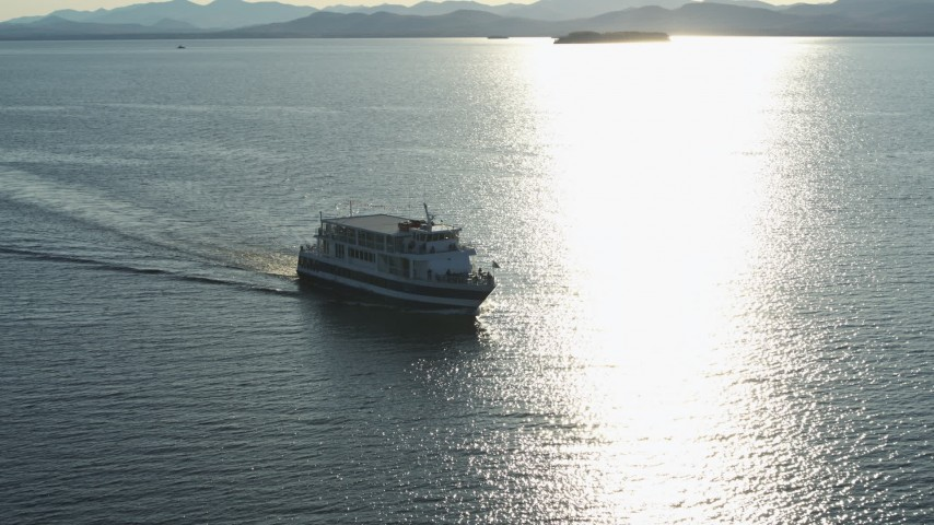 5.7K stock footage aerial video tracking a ferry on Lake Champlain near the lighthouse in Burlington, Vermont Aerial Stock Footage | DX0002_224_043