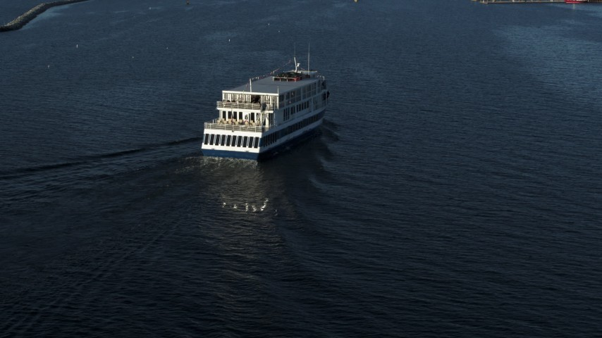 5.7K stock footage aerial video descend and orbit a ferry on Lake Champlain, Burlington, Vermont Aerial Stock Footage | DX0002_224_044