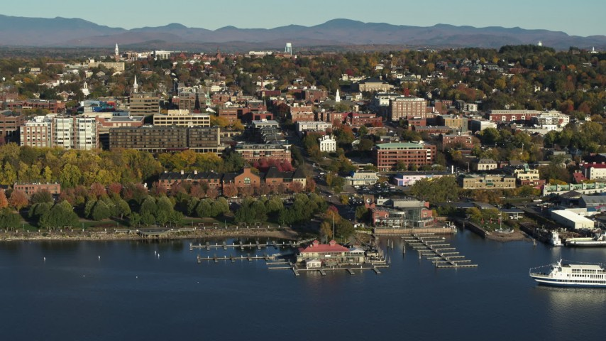 5.7K stock footage aerial video of a wide orbit of city building near a marina in downtown, Burlington, Vermont Aerial Stock Footage | DX0002_224_049