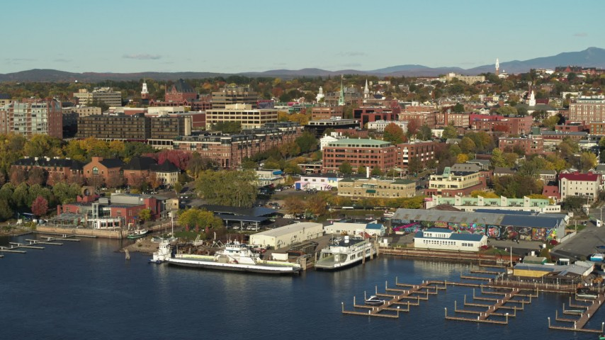 5.7K stock footage aerial video orbit around two marinas and city buildings in downtown, Burlington, Vermont Aerial Stock Footage | DX0002_224_052