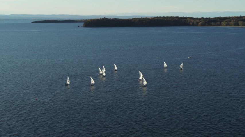 5.7K stock footage aerial video orbiting a group of sailboats on Lake Champlain, Burlington, Vermont Aerial Stock Footage | DX0002_224_053