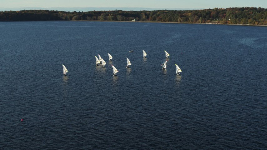 5.7K stock footage aerial video circling a group of sailboats on Lake Champlain, Burlington, Vermont Aerial Stock Footage | DX0002_224_054