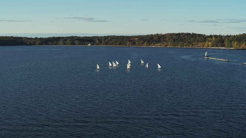 5.7K stock footage aerial video flying away from and orbiting a group of sailboats on Lake Champlain, Burlington, Vermont Aerial Stock Footage | DX0002_224_055