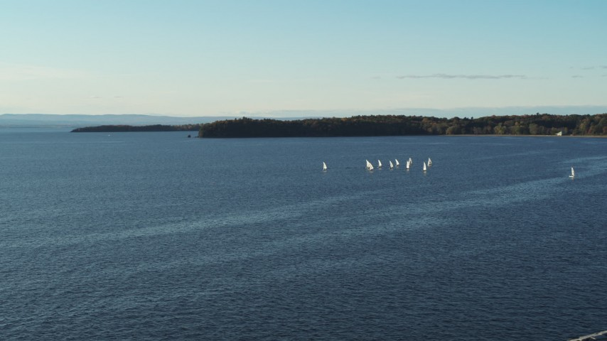 5.7K stock footage aerial video of a wide orbit of a group of sailboats on Lake Champlain, Burlington, Vermont Aerial Stock Footage | DX0002_224_056