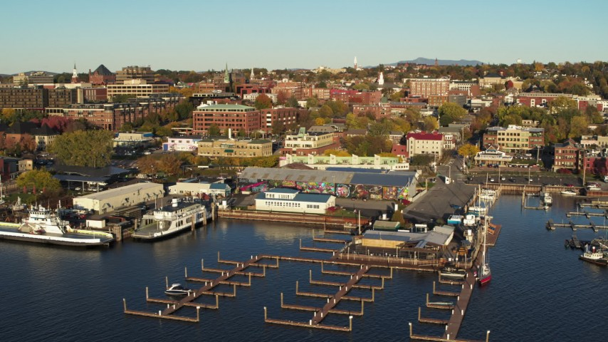 5.7K stock footage aerial video orbit around a marina and city buildings in downtown, reveal second marina, Burlington, Vermont Aerial Stock Footage | DX0002_224_057