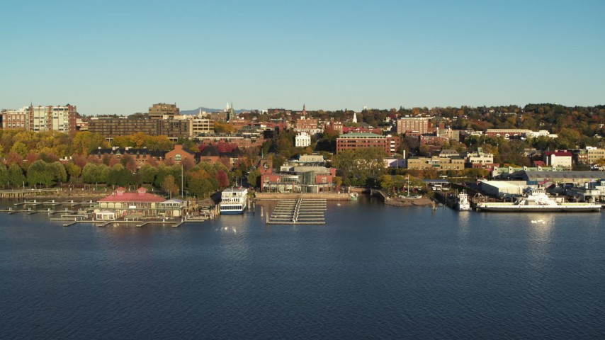 5.7K stock footage aerial video of city buildings near a marina, Burlington, Vermont Aerial Stock Footage | DX0002_224_061