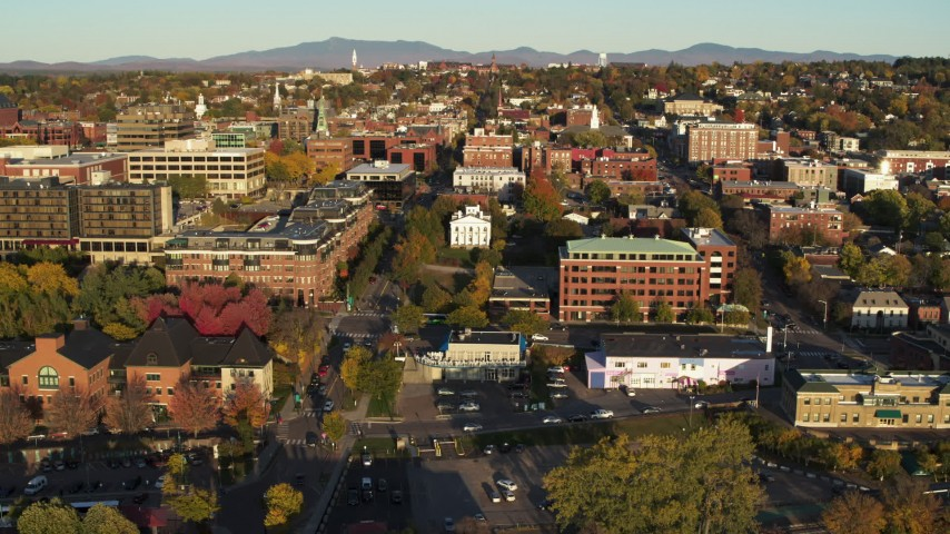 5.7K stock footage aerial video ascend over a marina while focused on office buildings in downtown, Burlington, Vermont Aerial Stock Footage | DX0002_224_063