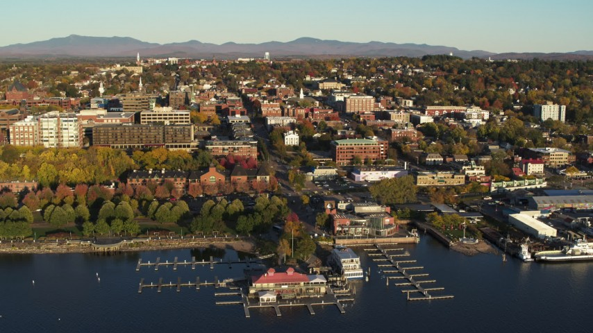 5.7K stock footage aerial video of flying away from downtown buildings and marina, Burlington, Vermont Aerial Stock Footage | DX0002_224_065