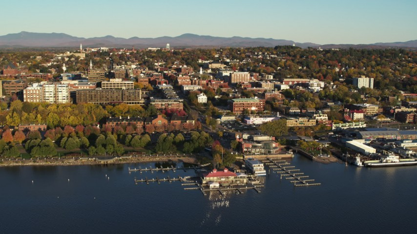 5.7K stock footage aerial video of a wide orbit of downtown buildings and marina, Burlington, Vermont Aerial Stock Footage | DX0002_224_066
