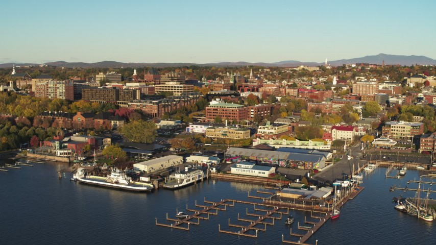 5.7K stock footage aerial video descend toward marina and orbit downtown buildings, Burlington, Vermont Aerial Stock Footage | DX0002_224_068