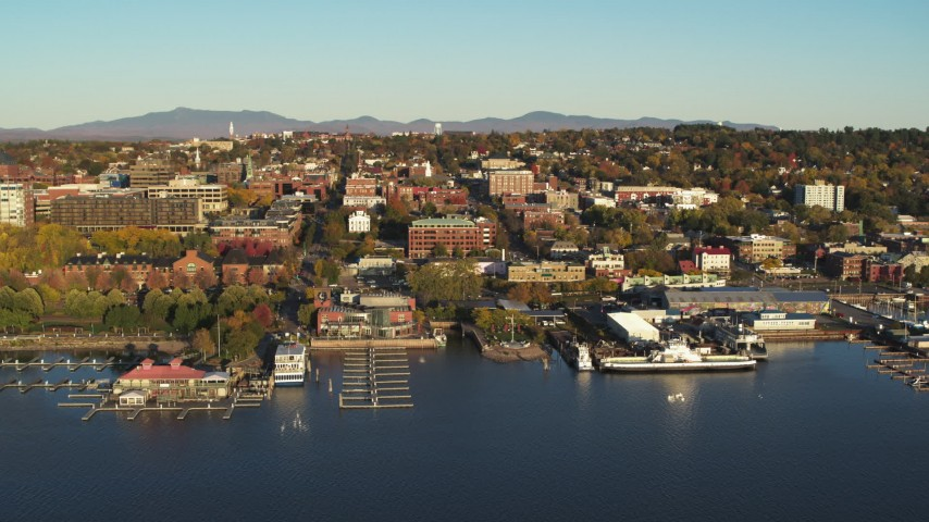 5.7K stock footage aerial video orbit around downtown buildings and Lake Champlain marinas, Burlington, Vermont Aerial Stock Footage | DX0002_224_069