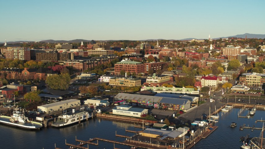 5.7K stock footage aerial video orbit downtown buildings behind Lake Champlain marina, Burlington, Vermont Aerial Stock Footage | DX0002_224_072