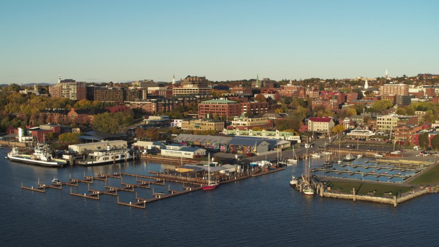 5.7K stock footage aerial video an orbit of downtown buildings behind Lake Champlain marina, Burlington, Vermont Aerial Stock Footage | DX0002_224_073