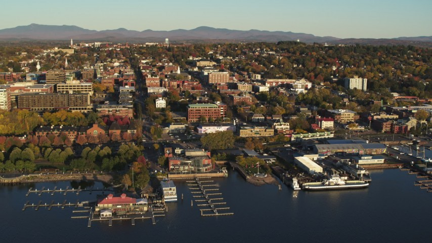5.7K stock footage aerial video of downtown's city buildings and marinas during approach to office building, Burlington, Vermont Aerial Stock Footage | DX0002_224_075