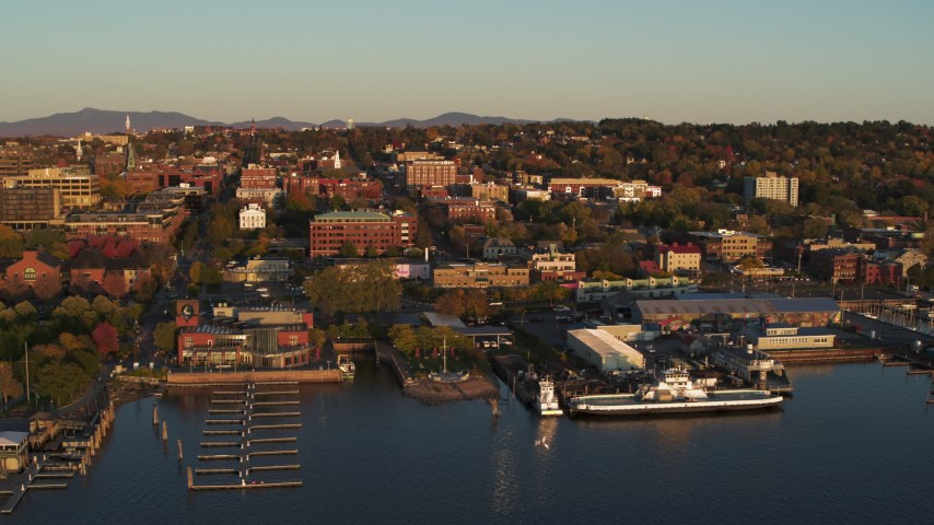 5.7K stock footage aerial video of buildings in downtown, seen while passing the marinas, Burlington, Vermont Aerial Stock Footage | DX0002_225_006
