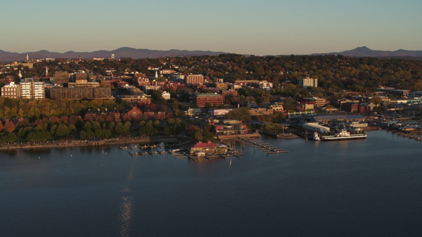 5.7K stock footage aerial video of flying away from park, buildings in downtown, and a marina, Burlington, Vermont Aerial Stock Footage | DX0002_225_007