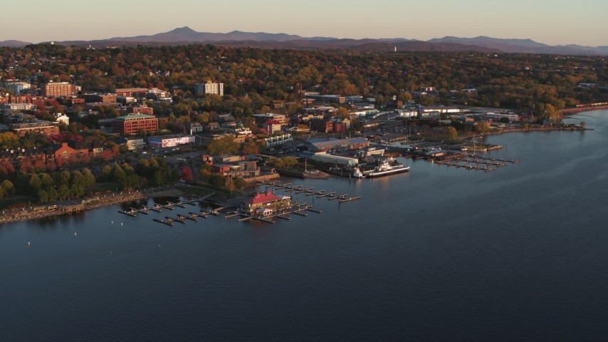 5.7K stock footage aerial video ascend toward marinas and buildings in downtown at sunset, Burlington, Vermont Aerial Stock Footage | DX0002_225_009
