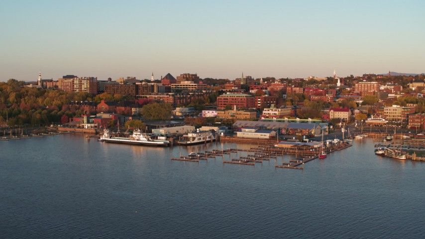 5.7K stock footage aerial video fly away from and orbit buildings in downtown behind marinas at sunset, Burlington, Vermont Aerial Stock Footage | DX0002_225_012