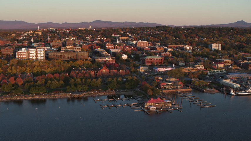 5.7K stock footage aerial video of buildings and park in downtown behind a marina at sunset, Burlington, Vermont Aerial Stock Footage | DX0002_225_014