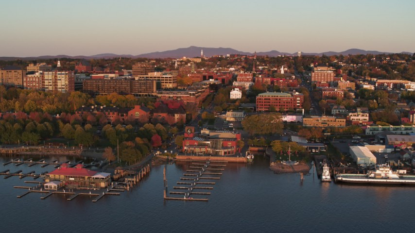 5.7K stock footage aerial video fly over marina toward downtown at sunset, Burlington, Vermont Aerial Stock Footage | DX0002_225_015