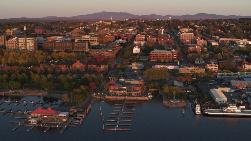 5.7K stock footage aerial video fly away from downtown and a marina at sunset, Burlington, Vermont Aerial Stock Footage | DX0002_225_016