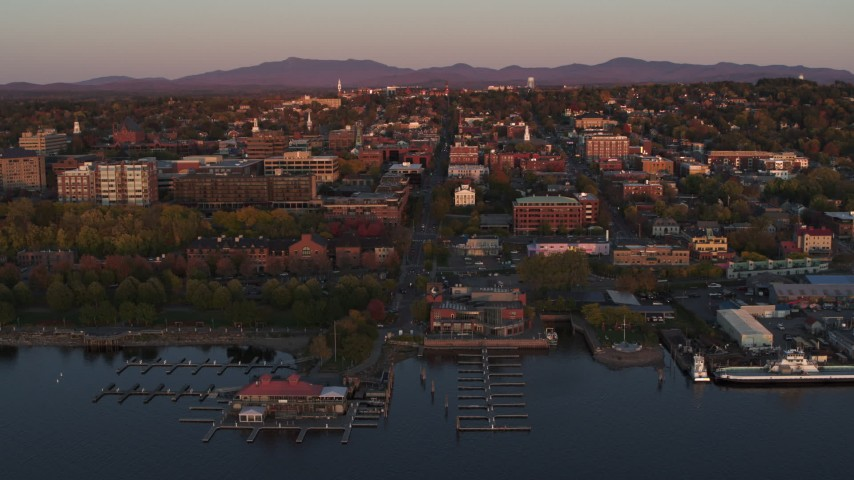 5.7K stock footage aerial video ascend away from downtown and marina at sunset, Burlington, Vermont Aerial Stock Footage | DX0002_225_020