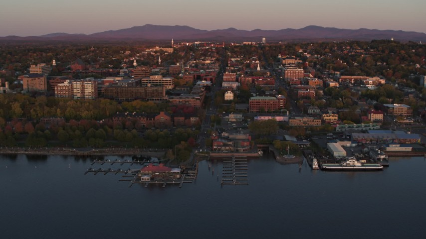 5.7K stock footage aerial video circling downtown and two marinas at sunset, Burlington, Vermont Aerial Stock Footage | DX0002_225_021