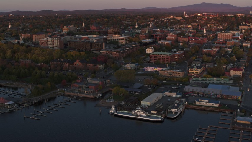 5.7K stock footage aerial video an orbit around downtown and two marinas at sunset, Burlington, Vermont Aerial Stock Footage | DX0002_225_022