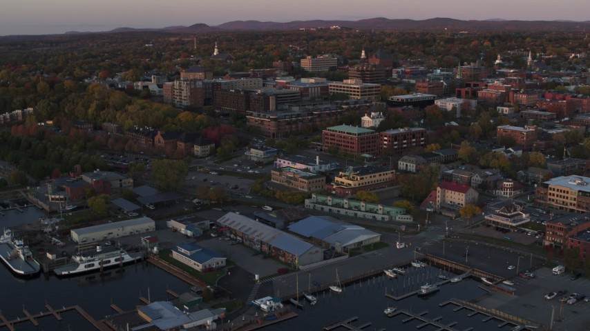 5.7K stock footage aerial video an orbit around a marina and downtown office buildings at sunset, Burlington, Vermont Aerial Stock Footage | DX0002_225_023